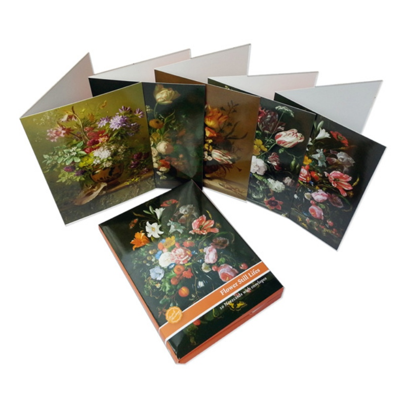 Three handmade greeting cards behind the \